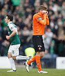 Blair Spittal hides his face after seeing his penalty kick saved by Hibs keeper Conrad Logan