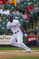 Round Rock Express outfielder Joey Butler #16 follows through on his swing against the New Orleans Zephyrs in the Pacific Coast League baseball game on April 21, 2013 at the Dell Diamond in Round Rock, Texas. Round Rock defeated New Orleans 7-1. (Andrew Woolley/Four Seam Images).