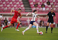 KASHIMA, JAPAN - AUGUST 2: Rose Lavelle #16 of the United States dribbles the ball during a game between Canada and USWNT at Kashima Soccer Stadium on August 2, 2021 in Kashima, Japan.