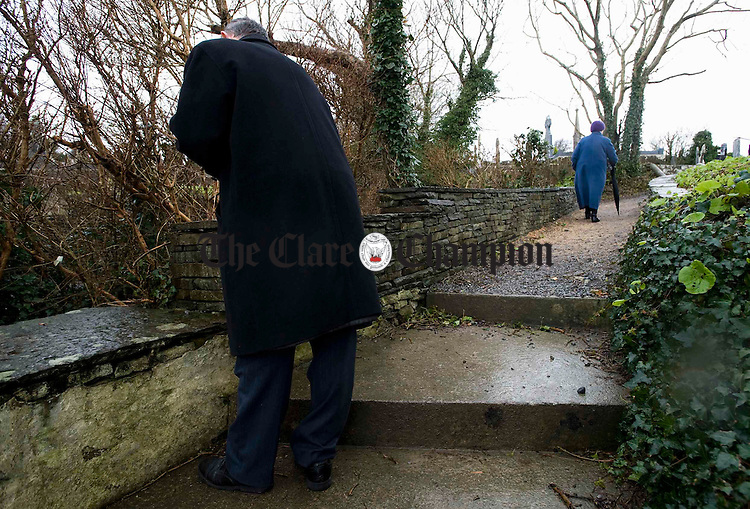 A couple do the prayer rounds at St Bridgid's Well on February 1st, for the feast of St Bridgid. Photograph by John Kelly.
