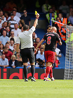 Pictured L-R: Match referee Kevin Friend shown Jonjo Shelvey of Swansea a yellow card for his foul against Eden Hazard of Chelsea. Saturday 13 September 2014<br /> Re: Premier League Chelsea FC v Swansea City FC at Stamford Bridge, London, UK.