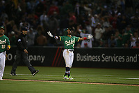 OAKLAND, CA - JULY 3:  Tony Kemp #5 of the Oakland Athletics celebrates after hitting a game-winning sacrifice fly in the bottom of the 12th inning against the Boston Red Sox at the Oakland Coliseum on Saturday, July 3, 2021 in Oakland, California. (Photo by Brad Mangin)