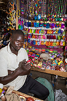 Senegal, Touba.  Young Man Selling Plastic Ear Rings and Bracelets.