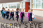 Robyn Nagle and Feile Flynn lead the line for the junior infants in to CAstledrum NS on Wednesday
