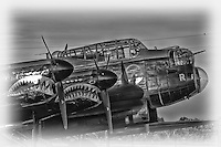 An up close profile view of the Avro Lancaster bomber on the tarmac in black and white at the Canadian Warplane Heritage Museum in Hamilton.