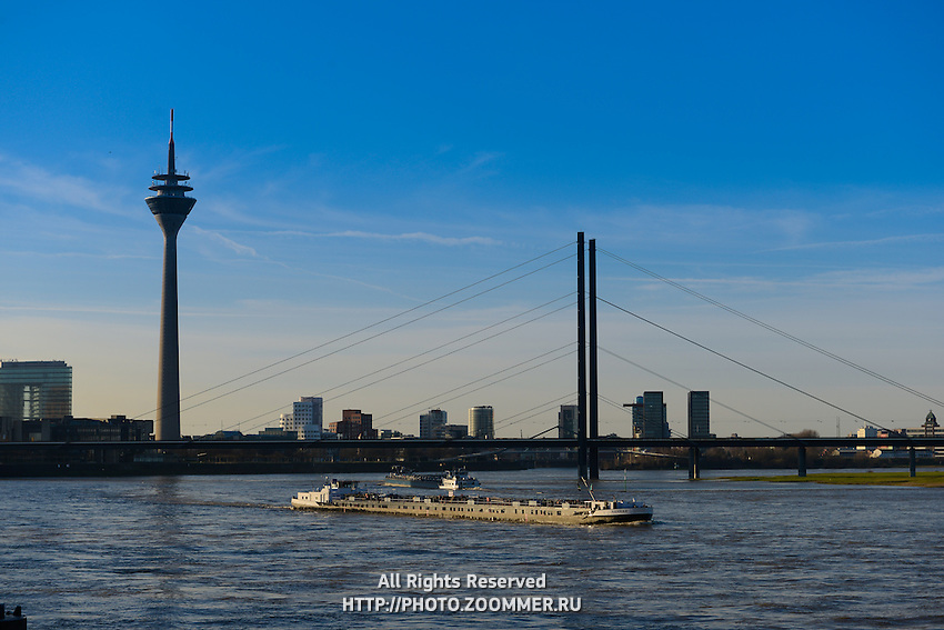 Barge On Rhine river under the bridge,  Dusseldorf, Germany