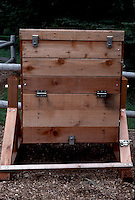 Composting in wooden bin with hinges and stages sections