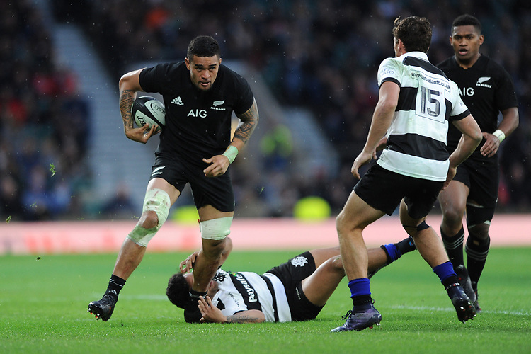 Vaea Fifita of New Zealand breaks through the tackle of Vince Aso of Barbarians during the 125th Anniversary Match between Barbarians and New Zealand at Twickenham Stadium on Saturday 4th November 2017 (Photo by Rob Munro/Stewart Communications)