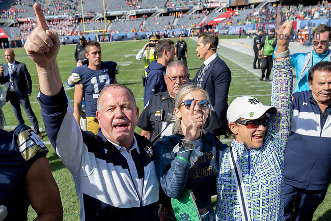 September 25, 2021; Head football coach Brian Kelly celebrates after the win against Wisconsin in the Shamrock Series game at Soldier Field in Chicago. (photo by Matt Cashore)