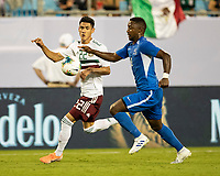 CHARLOTTE, NC - JUNE 23: Samuel Camille #18 and Uriel Antuna #22 contest the ball during a game between Mexico and Martinique at Bank of America Stadium on June 23, 2019 in Charlotte, North Carolina.