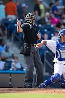 Home plate umpire David Soucy makes a strike call during the International League game between the Louisville Bats and the Durham Bulls at Durham Bulls Athletic Park on August 9, 2015 in Durham, North Carolina.  The Bulls defeated the Bats 9-0.  (Brian Westerholt/Four Seam Images)