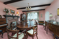BNPS.co.uk (01202) 558833. <br /> Pic: SandersonYoung/BNPS<br /> <br /> Dining room.<br /> <br /> A quirky 'show home' for a brickwork owner where Lewis Carroll is believed to have stayed while writing some of his Alice in Wonderland books is on the market for just under £1m.<br /> <br /> Red Cottage is a striking Grade II listed property in Whitburn, Tyne and Wear, where Charles Dodgson, otherwise known as Lewis Carroll, regularly visited family.<br /> <br /> The unusual 179-year-old home was built to show off as many design features as possible, and has a walled garden and even an air raid shelter.
