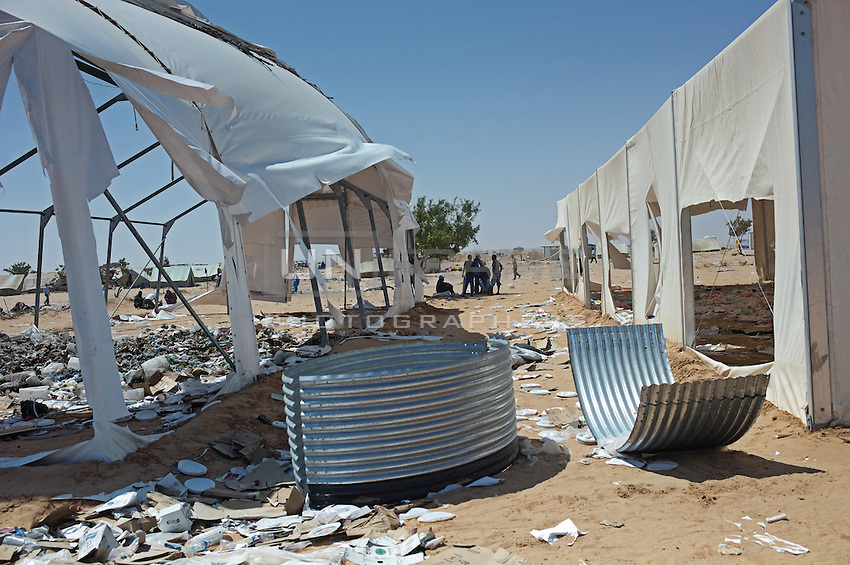 A few nights ago refugees from another group attacked and burned some tents. Two people died in the fire.