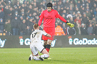 Petr Cech of Arsenal helps Sam Clucas of Swansea to his feet after being tackled by Mohamed Elneny of Arsenal during the Premier League match between Swansea City and Arsenal at the Liberty Stadium, Swansea, Wales, UK. Tuesday 30 January 2018