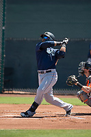 Seattle Mariners first baseman Onil Pena (62) follows through on his swing during an Extended Spring Training game against the San Francisco Giants Orange at the San Francisco Giants Training Complex on May 28, 2018 in Scottsdale, Arizona. (Zachary Lucy/Four Seam Images)