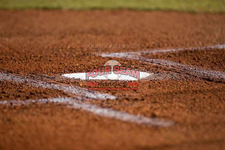 The lines are painted and the clay is raked around home plate in preparation for the start of the Conference USA baseball game between the Rice Owls and the Charlotte 49ers at Hayes Stadium on March 6, 2015 in Charlotte, North Carolina.  The Owls defeated the 49ers 4-2.  (Brian Westerholt/Four Seam Images)