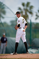 Pittsburgh Pirates pitcher Austin Shields (17) checks the runner at first base during an Instructional League game against the Detroit Tigers on October 6, 2017 at Pirate City in Bradenton, Florida.  (Mike Janes/Four Seam Images)