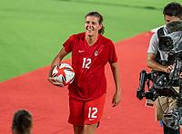 YOKOHAMA, JAPAN - AUGUST 6: Christine Sinclair #12 of Canada walks off the field after a game between Canada and Sweden at International Stadium Yokohama on August 6, 2021 in Yokohama, Japan.