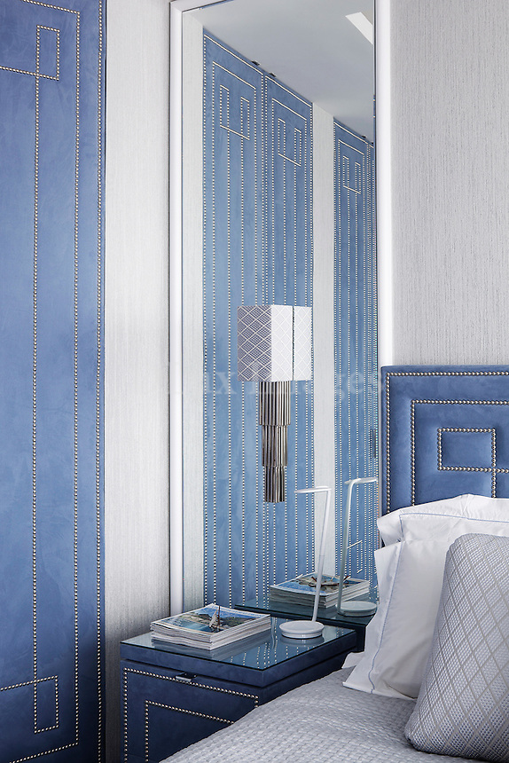 Modern classic bedroom with blue accents