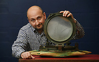 BNPS.co.uk (01202 558833)<br /> Pic: ZacharyCulpin/BNPS<br /> <br /> Auctioneer Andrew Aldridge pictured with the salvaged Carpathia port hole that sold for £24,000  <br /> <br /> Relics salvaged from the sunken ship that rescued the Titanic survivors have sold at auction for £135,000.<br /> <br /> The rare items included the engine room order telegraph the captain of the Carpathia used after he received the SOS from Titanic.<br /> <br /> He moved the handle to 'Full Steam Ahead', instructing staff in the engine room to rapidly increase speed