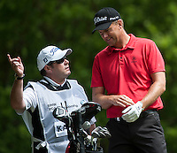 24.05.2015. Wentworth, England. BMW PGA Golf Championship. Final Round.  Robert Karlsson [SWE] talks to his caddie on the  3rd hole during the final round of the 2015 BMW PGA Championship from The West Course Wentworth Golf Club