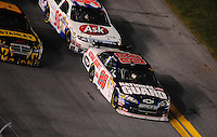 Feb 07, 2009; Daytona Beach, FL, USA; NASCAR Sprint Cup Series driver Dale Earnhardt Jr (88) leads the field during the Bud Shootout at Daytona International Speedway. Mandatory Credit: Mark J. Rebilas-