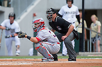 Syracuse Chiefs catcher Jhonatan Solano (23) sets a target as home plate umpire Paul Clemons looks on during the game against the Charlotte Knights at BB&T BallPark on June 1, 2016 in Charlotte, North Carolina.  The Knights defeated the Chiefs 5-3.  (Brian Westerholt/Four Seam Images)