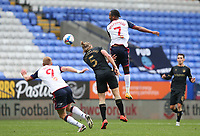 Bolton Wanderers' Nathan Delfouneso rises above Oldham Athletic's Carl Piergianni<br /> <br /> Photographer Stephen White/CameraSport<br /> <br /> The EFL Sky Bet League Two - Bolton Wanderers v Oldham Athletic - Saturday 17th October 2020 - University of Bolton Stadium - Bolton<br /> <br /> World Copyright © 2020 CameraSport. All rights reserved. 43 Linden Ave. Countesthorpe. Leicester. England. LE8 5PG - Tel: +44 (0) 116 277 4147 - admin@camerasport.com - www.camerasport.com