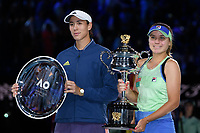 January 1, 2020: Runner up GARBIÑE MUGURUZA (ESP) and winner 14th seed SOFIA KENIN (USA) pose for photographs after the Women's Singles Final match on day 13 of the Australian Open 2020 in Melbourne, Australia. Photo Sydney Low. Kenin won 46 62 62