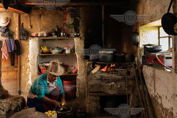 Lydia Lluya, the wife of farmer and mountain guide Saul Lluya, prepares lunch at their home in the Llupa community in rural Huaraz. Saul is suing a German energy company, seeking compensation for shrinking glaciers in Peru. The accelerated melting of the Peruvian glaciers represent a dual threat to the population of the region. In the long term, the disappearance of the glaciers would lead to the end of the water supply, on the other hand, their rapid melting has the potential to cause a catastrophe as avalanches into glacial lagoons can create massive waves, generating mudslides that could be devastating for nearby Huaraz, as happened in 1941, when 2,000 people died.