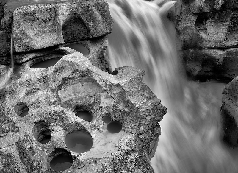 Potholes carved by river. Lower Sunwapta Falls. Jasper National Park, Alberta, Canada