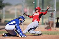 Cincinnati Reds shortstop Luis Gonzalez (59) slides into home as Chase Vallot fields the ball during an Instructional League game against the Kansas City Royals on October 16, 2014 at Goodyear Training Complex in Goodyear, Arizona.  (Mike Janes/Four Seam Images)