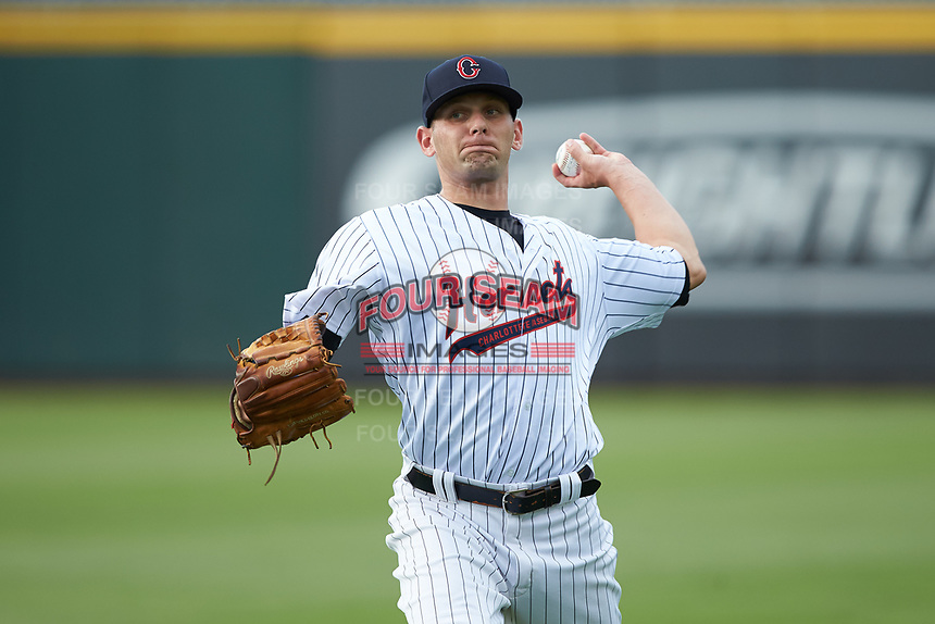 Charlotte Hornets starting pitcher Kyle Kubat (19) warms up in the outfield prior to the game against the Louisville Bats at BB&T BallPark on June 22, 2019 in Charlotte, North Carolina. The Hornets defeated the Bats 7-6. (Brian Westerholt/Four Seam Images)