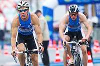 28 APR 2012 - LES SABLES D'OLONNE, FRA -  Tommy Zaferes (Saint Raphael Triathlon) (left) leads team mate Beau Smith from the mount line during the prologue round of the French Grand Prix Series triathlon in Les Sables d'Olonne, France .(PHOTO (C) 2012 NIGEL FARROW)