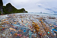 pollution, marine debris, plastic wastes wash ashore on a remote island in Raja Ampat, West Papua, Indonesia, Indo-Pacific Ocean