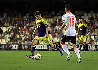Valencia, Spain. Thursday 19 September 2013<br /> Pictured L-R: Ben Davies of Swansea against Javier Fuego of Valencia<br /> Re: UEFA Europa League game against Valencia C.F v Swansea City FC, at the Estadio Mestalla, Spain,