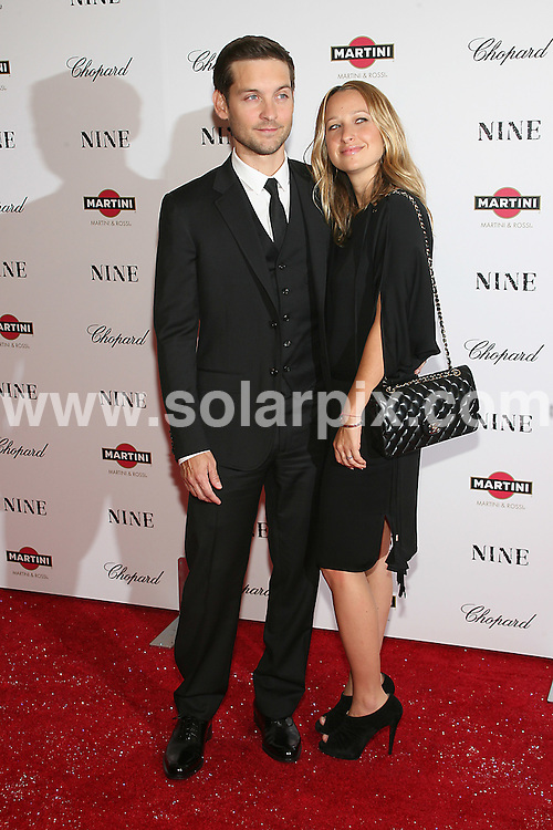 **ALL ROUND PICTURES FROM SOLARPIX.COM**.**SYNDICATION RIGHTS FOR UK, AUSTRALIA, DENMARK, PORTUGAL, S. AFRICA, SPAIN & DUBAI (U.A.E) ONLY**.arrivals for Nine, the New York Premiere at the Ziegfeld Theater, New York City, NY, USA. 15 December 2009..This pic: Tobey Maguire and Jennifer Meyer..JOB REF: 10413 PHZ Gaboury  DATE: 15_12_2009.**MUST CREDIT SOLARPIX.COM OR DOUBLE FEE WILL BE CHARGED**.**MUST NOTIFY SOLARPIX OF ONLINE USAGE**.**CALL US ON: +34 952 811 768 or LOW RATE FROM UK 0844 617 7637**
