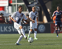 LA Galaxy midfielder Marcelo Sarvas (8) controls the ball at midfield.  In a Major League Soccer (MLS) match, the New England Revolution (blue) defeated LA Galaxy (white), 5-0, at Gillette Stadium on June 2, 2013.