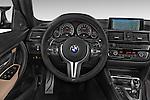 Car pictures of steering wheel view of a 2018 BMW M3 4 Door Sedan Steering Wheel