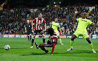 Romaine Sawyers of Brentford goes to ground in the penalty area during the Sky Bet Championship match between Brentford and Derby County at Griffin Park, London, England on 26 September 2017. Photo by Carlton Myrie / PRiME Media Images.