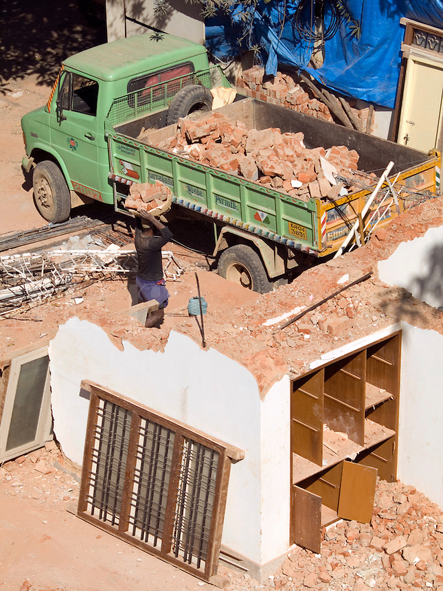 Laborers manually demolish a house in Bangalore, Karnataka, India