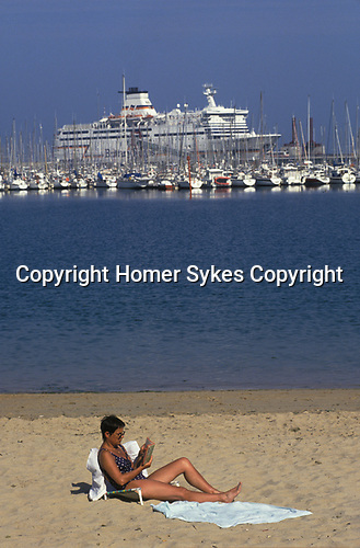 Brittany Ferries boats and yachts in harbour St Malo beach with people on holiday France Europe 2000s