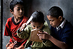 Three boys share the only mirror in an orphanage in Pokhara, Nepal.