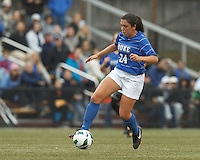 Duke University forward Mollie Pathman (24) controls the ball.Boston College (white) defeated Duke University (blue/white), 4-1, at Newton Campus Field, on October 6, 2013.