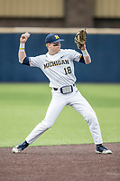 Michigan Wolverines shortstop Jack Blomgren (18) makes a throw to first base against the Maryland Terrapins on April 13, 2018 in a Big Ten NCAA baseball game at Ray Fisher Stadium in Ann Arbor, Michigan. Michigan defeated Maryland 10-4. (Andrew Woolley/Four Seam Images)