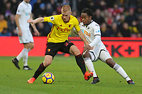 (L-R) Ben Watson of Watford challenged by Renato Sanches of Swansea City during the Premier League match between Watford and Swansea City at the Vicarage Road, Watford, England, UK. Saturday 30 December 2017