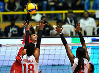 BOGOTÁ-COLOMBIA, 08-01-2020: Margarita Martínez y Valerin Carabalí de Colombia, intentan un bloqueo al ataque de balón a Magullaura Frias de Perú, durante partido entre Perú y Colombia en el Preolímpico Suramericano de Voleibol, clasificatorio a los Juegos Olímpicos Tokio 2020, jugado en el Coliseo del Salitre en la ciudad de Bogotá del 7 al 9 de enero de 2020. / Margarita Martínez and Valerin Carabali from Colombia, trie to block the attack the ball to Magullaura Frias from Peru, during a match between Peru and Colombia, in the South American Volleyball Pre-Olympic Championship, qualifier for the Tokyo 2020 Olympic Games, played in the Colosseum El Salitre in Bogota city, from January 7 to 9, 2020. Photo: VizzorImage / Luis Ramírez / Staff.