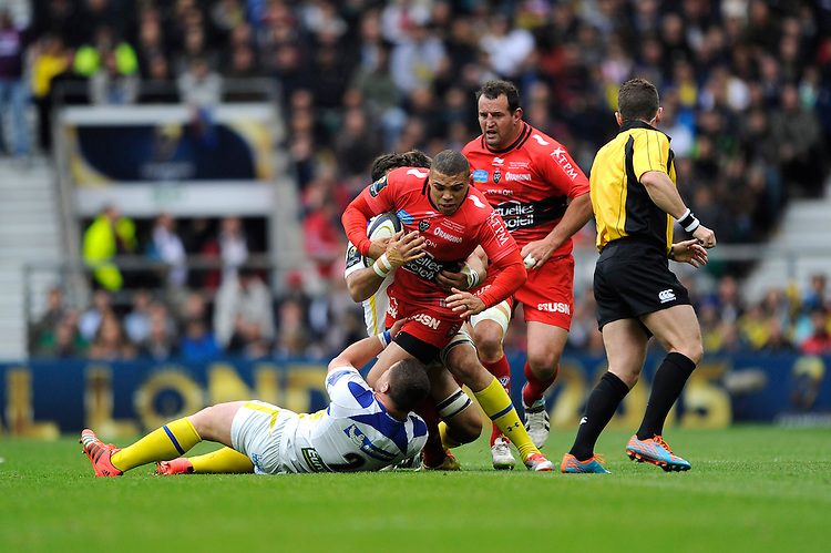 Bryan Habana of RC Toulon is tackled by Benjamin Kayser of ASM Clermont Auvergne