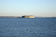 Fort Gorges from Spring Point Ledge Light  during the winter months. Located in South Portland, Maine  USA,  which is part of the New England seacoast.  .Notes:  This fort is located in Portland Harbor.