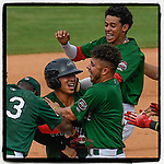 Third baseman Tanner Nishioka (30) of the Greenville Drive, in helmet, is swamped by teammates after getting a walk-off hit to win a game against the Asheville Tourists, 7-6, on Sunday, June 3, 2018, at Fluor Field at the West End in Greenville, South Carolina. Greenville won, 7-6. (Tom Priddy/Four Seam Images)